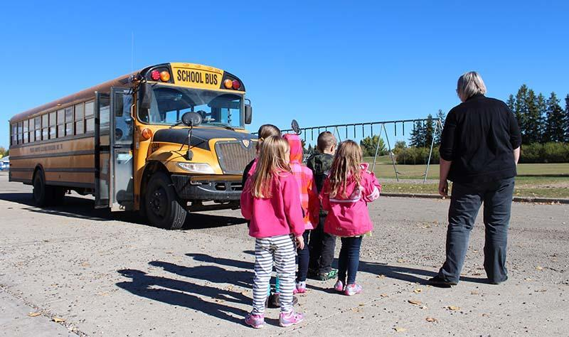 young students undergoing bus safety training