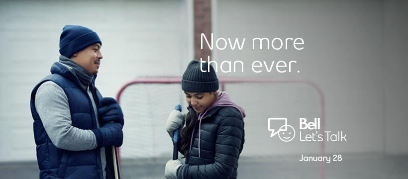 "Father and daughter take a break while playing hockey in front of their garage. Text: ""Now more than ever"". Bell Let's Talk logo"