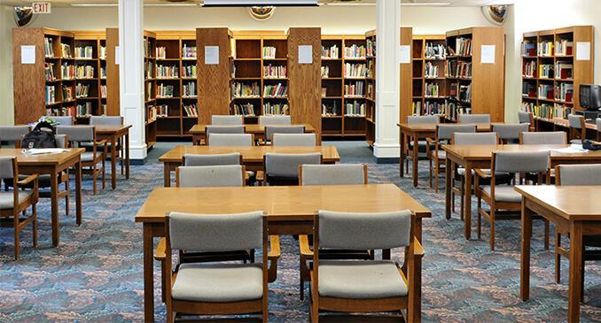 Photo of CHSS library - tables, chairs, carpeted floor