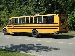 A picture of a bus sitting along side of the road