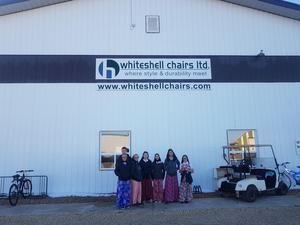 Whiteshell Colony students in front of the building where Whiteshell Chairs in located and the business is run