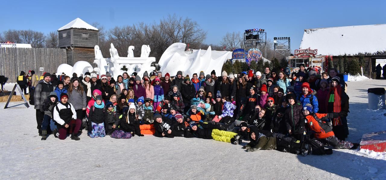 Students and teachers in front of ice sculptures at Festival du Voyageur.