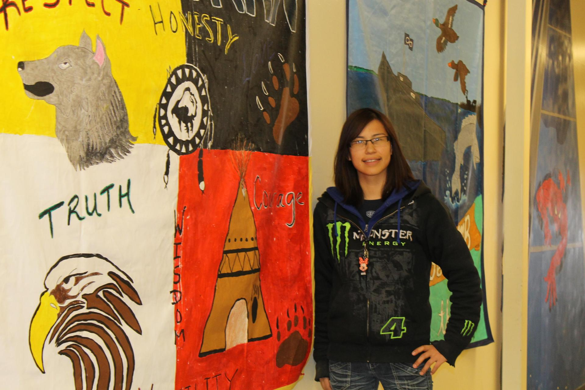 student with Indigenous art
