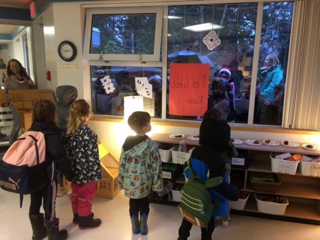 Kindergarten watching the carolers