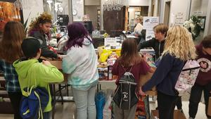 Students organizing food and boxing up the food to donate to the food bank.