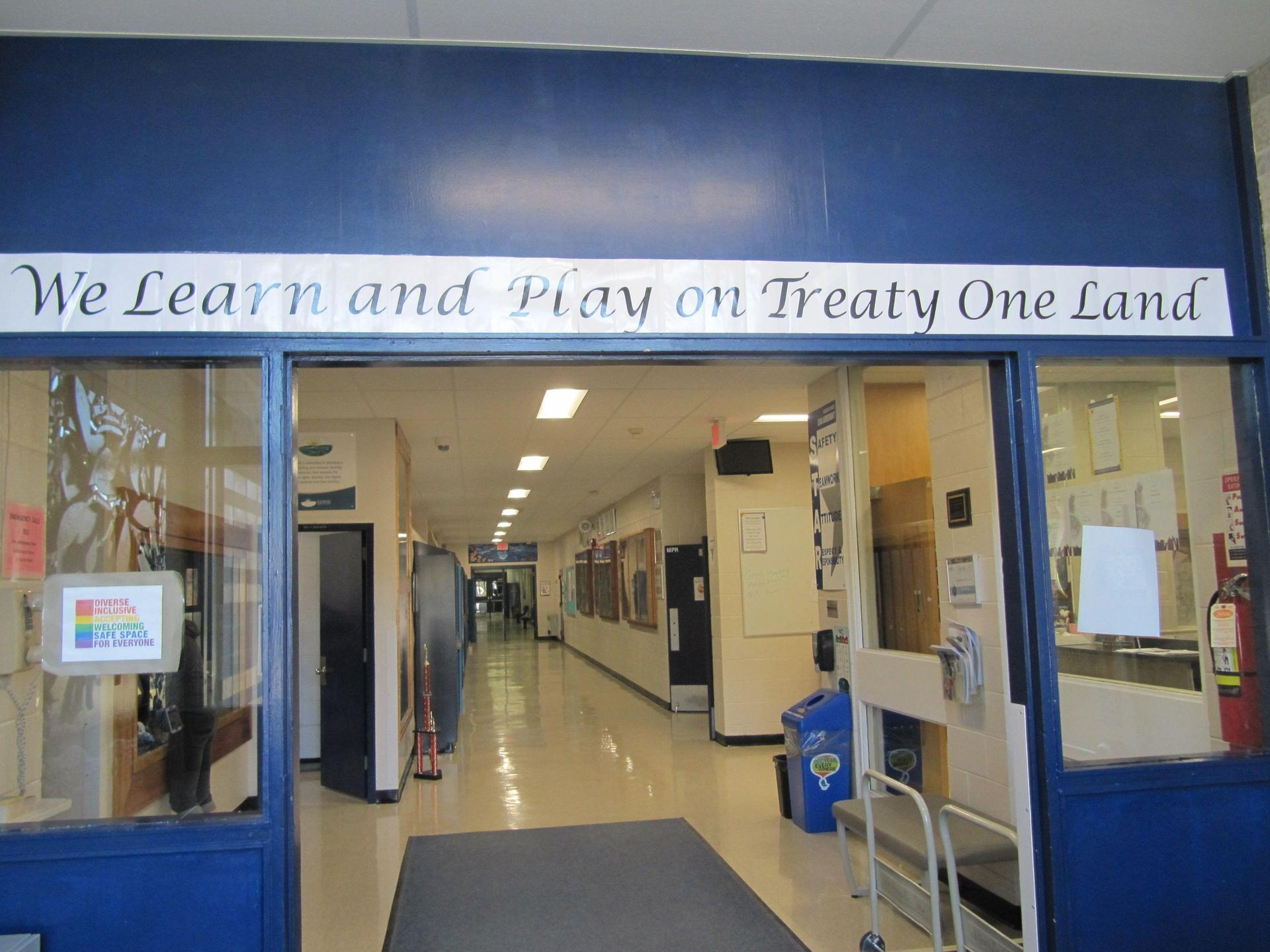 We Learn and Play on Treaty One Land banner in school entrance