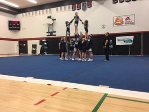 Stunt performed by cheerleaders