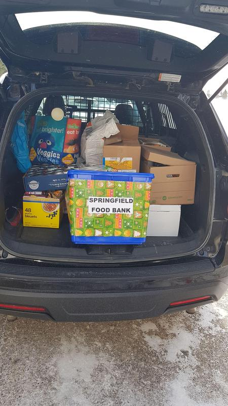 A van is full of food that is being donated to the food bank.