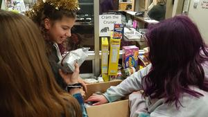 Students organizing food that was collected for the food bank.