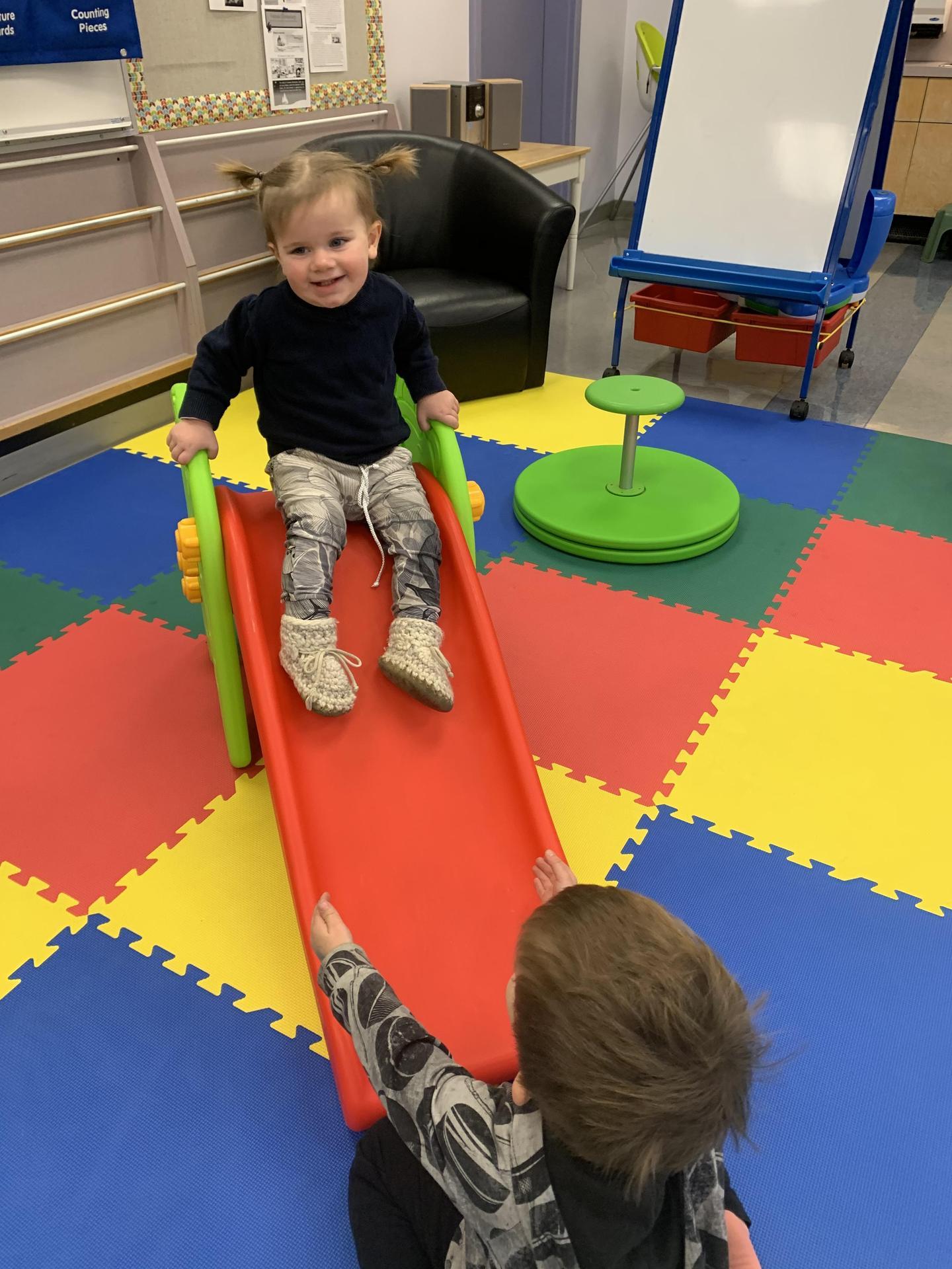toddler on a slide