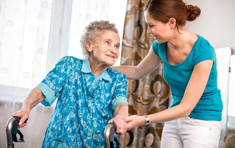 Personal Support Worker helping an elderly client.