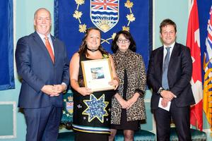 Jeannine Lindsay is presented her award of excellence by John Horgen, BC Premier, Lt. Gov.  Janet Austin, and Rob Fleming, Minister of Education