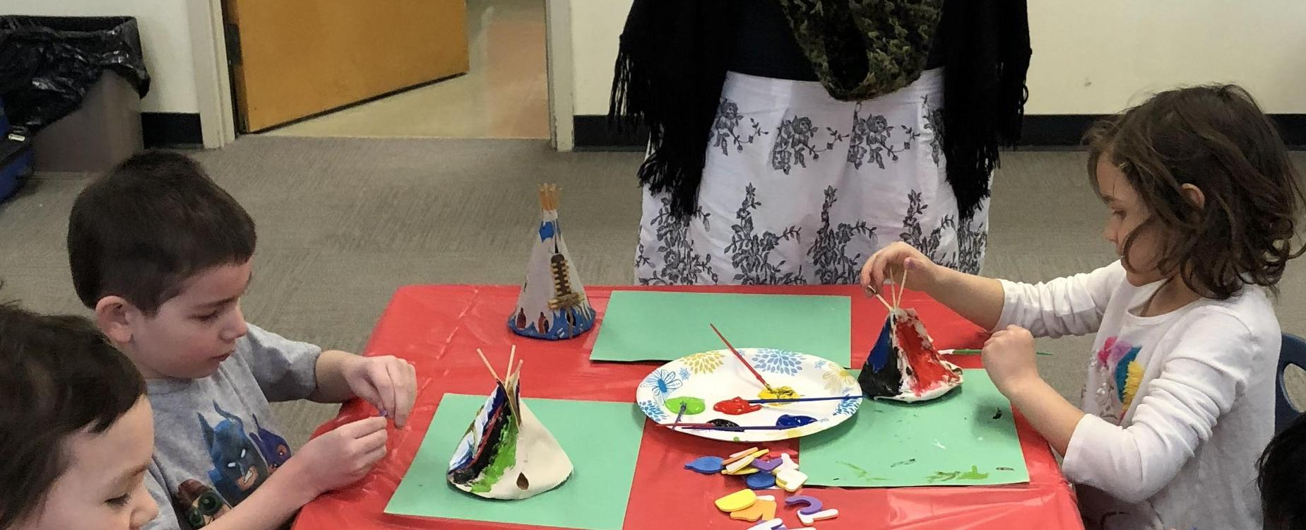 children painting teepees
