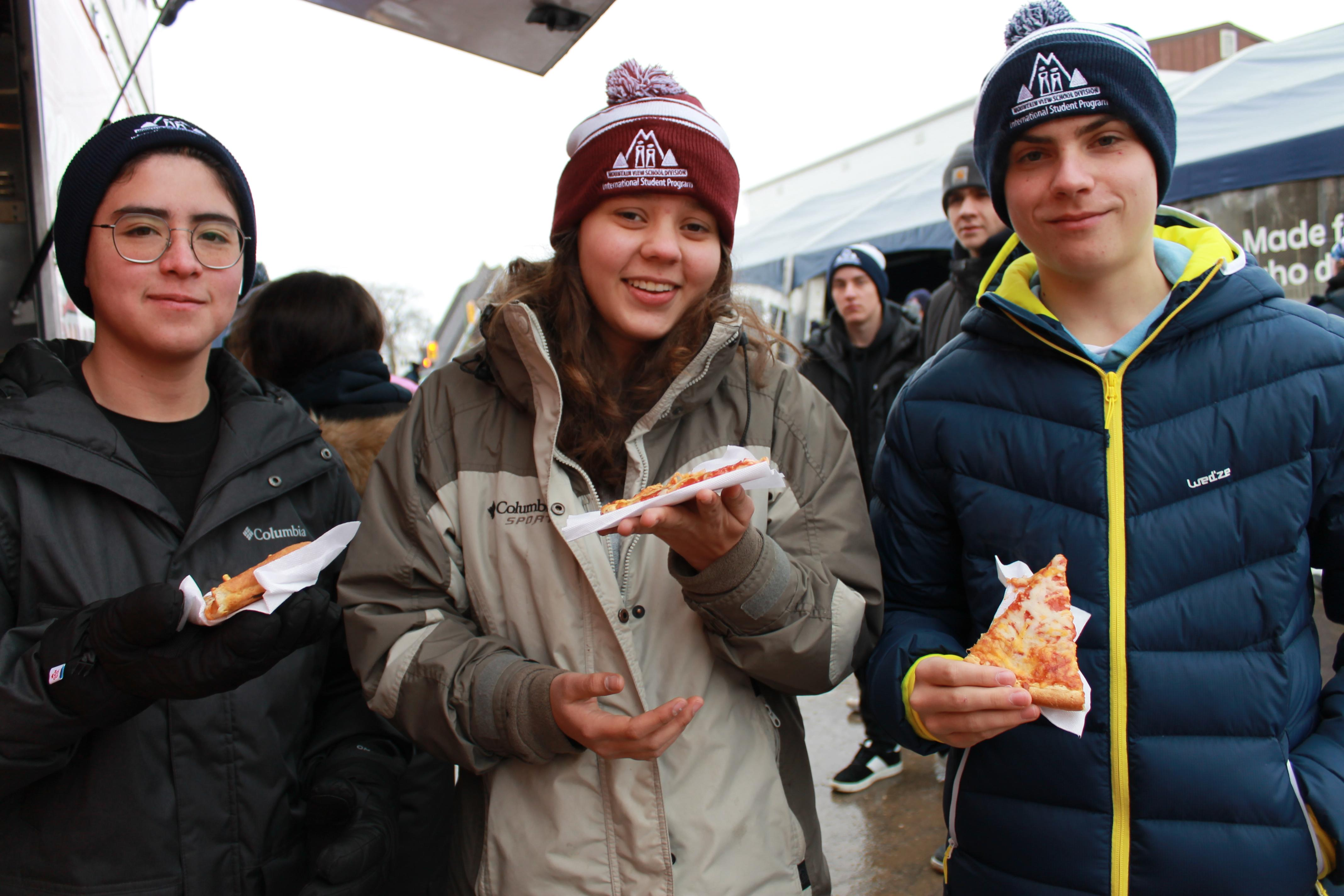 students enjoying free pizza