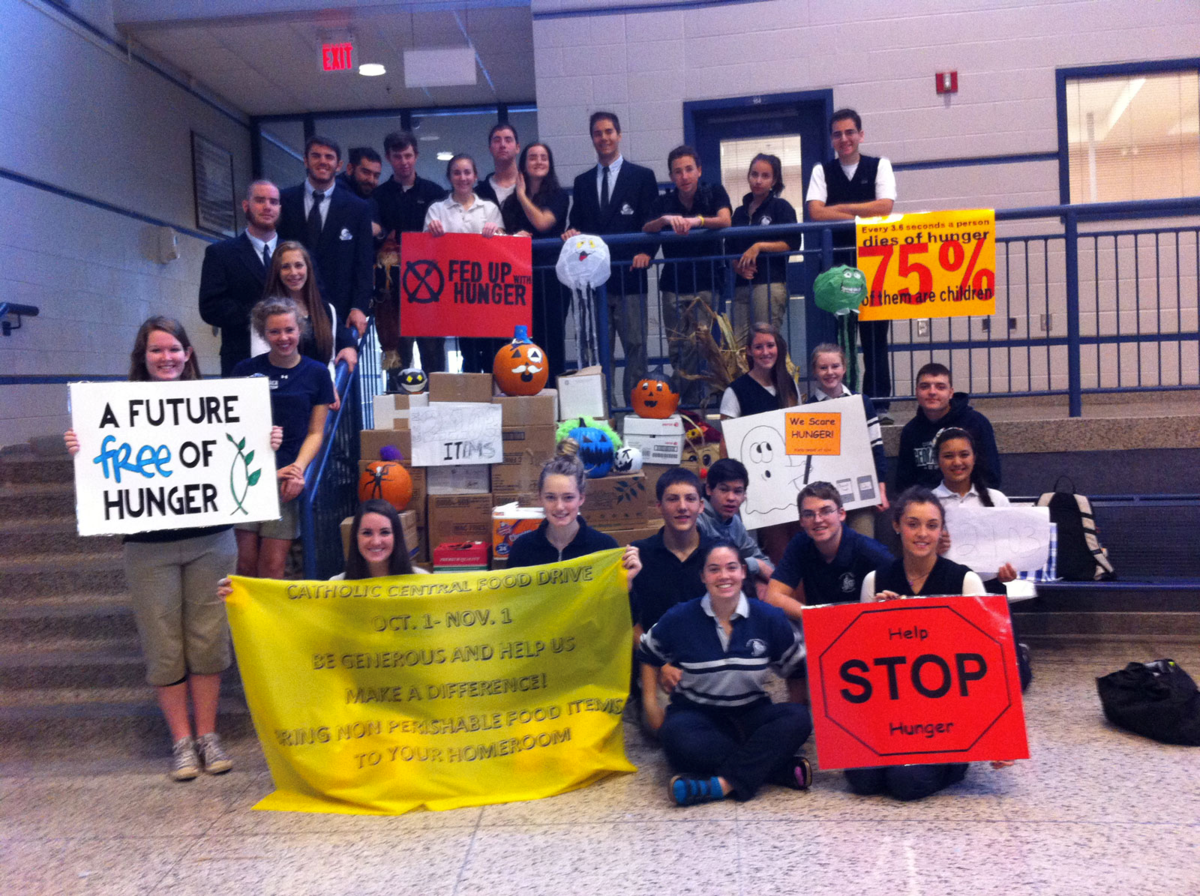 Geography club holding signs