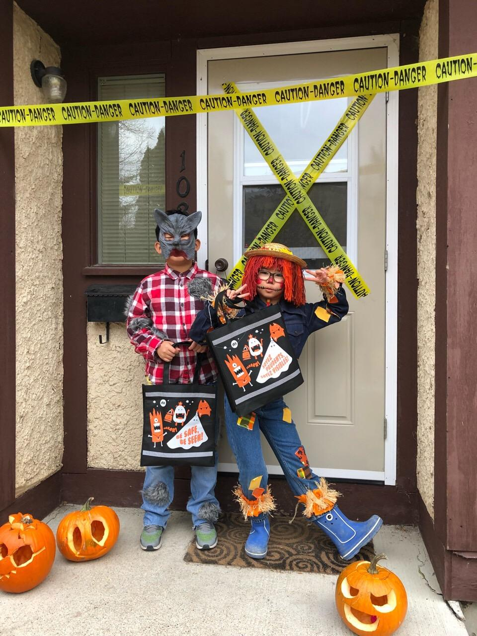 our youngest trick or treaters dresses as wearwolf and scarecrow