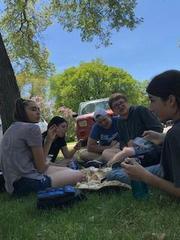 Students picnicking at park.