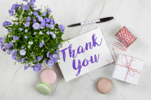 thank you note, flowers and treats
