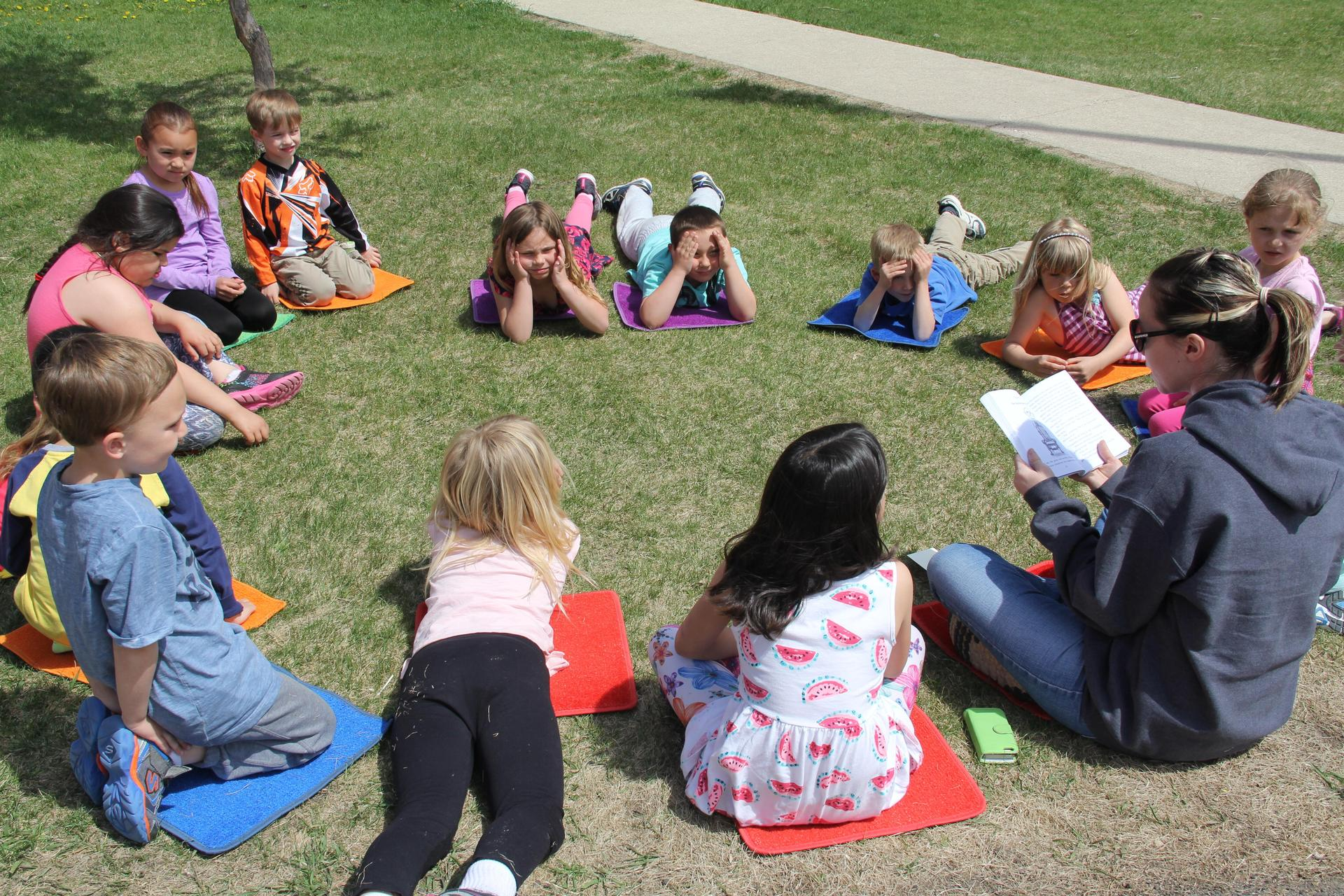 students reading outside