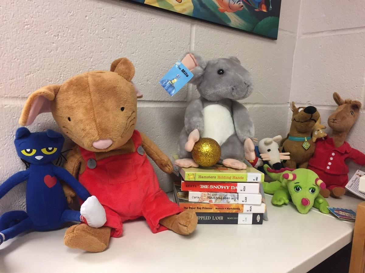 Stuffed animals with books