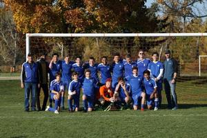 Team photo of Sr. Boys Soccer team after winning the final game of the Valley Championships