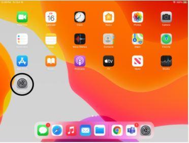 ipad with several apps with the 'settings' icon circled