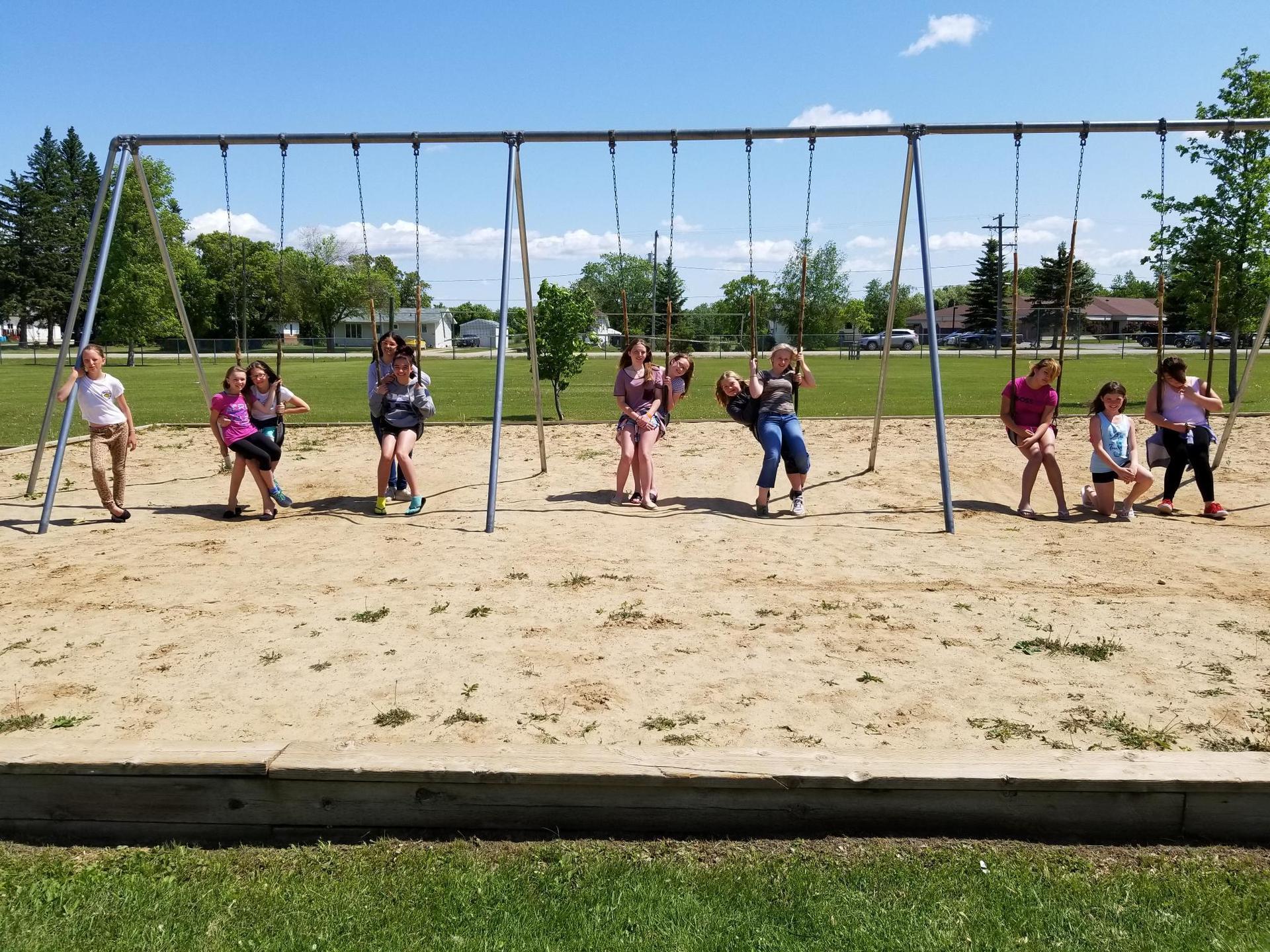 students on swingset