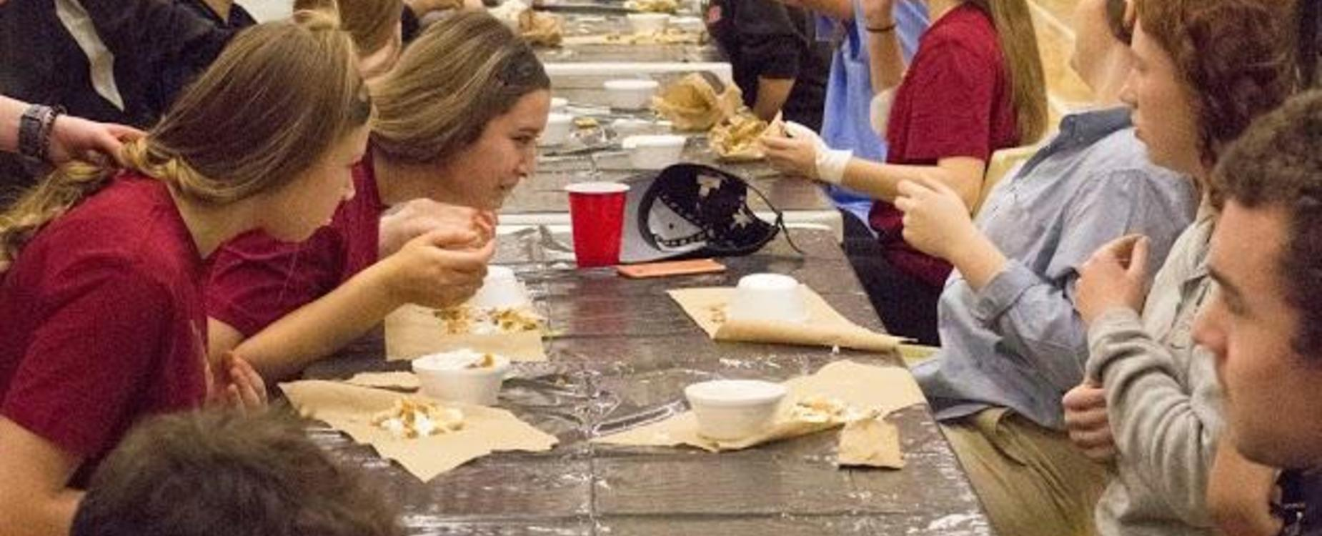 Students participating in a pie eating contest