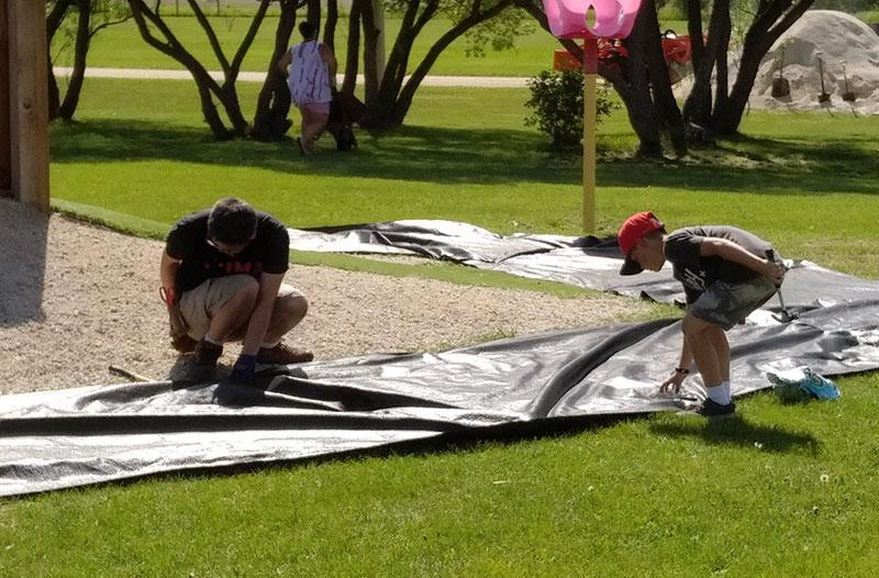 Image of people building playground.