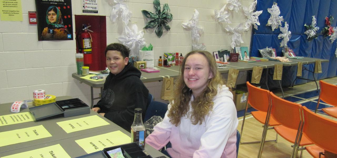 Students selling raffle tickets at the Christmas Concert.