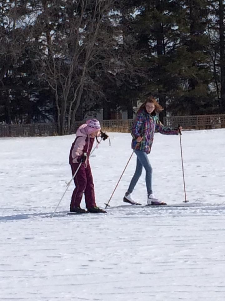 students cross-country skiing
