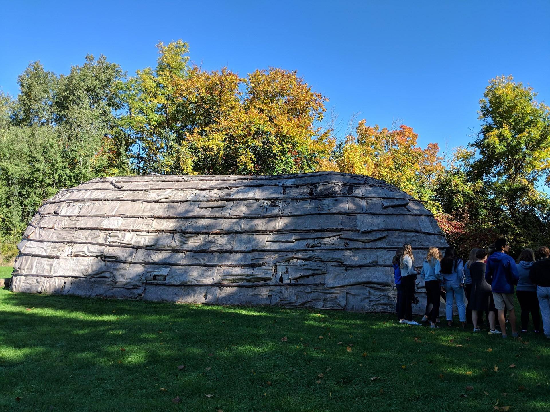 Students standing near giant rock