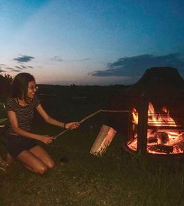 girl roasting a hot dog