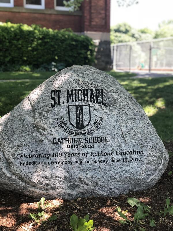 Commemorative rock outside of St. Michael Catholic School