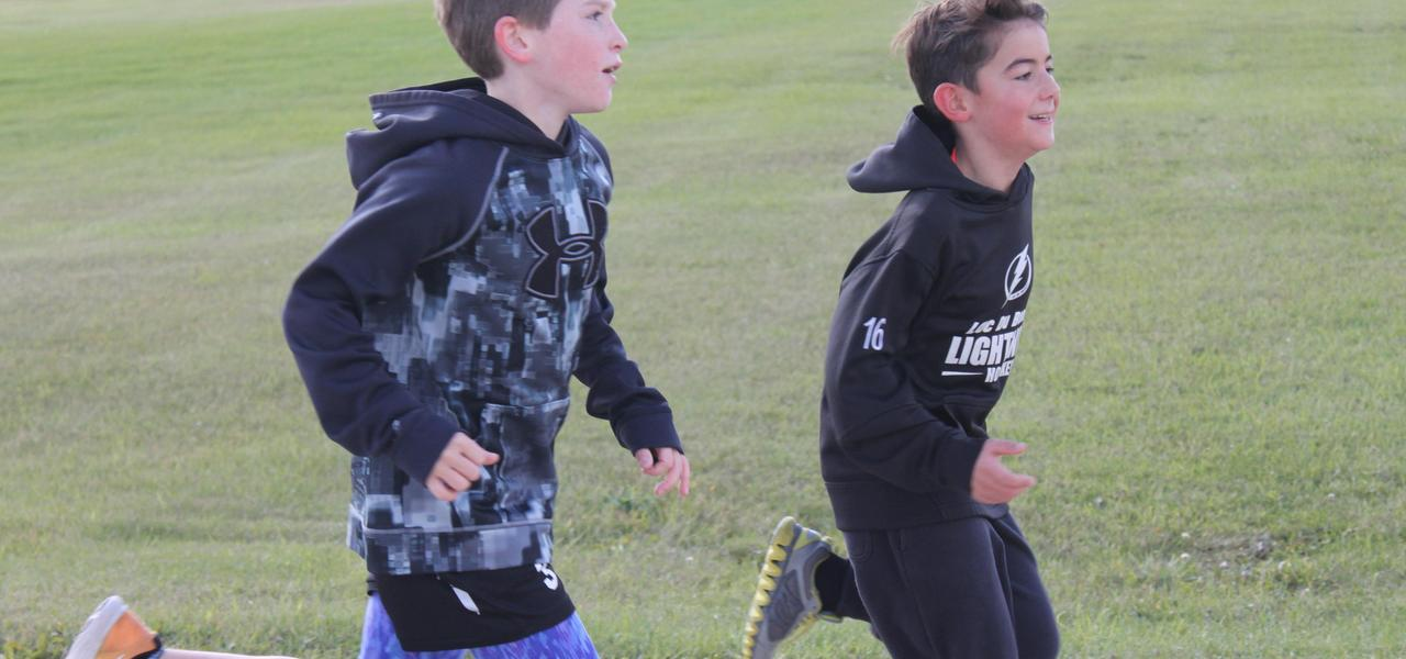 Two students running in the Terry Fox Run
