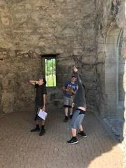 Boys under bell tower