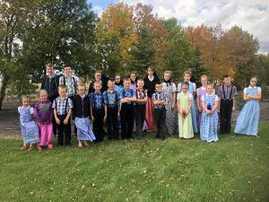 Richland School students standing in a group for a photo.  They are outside in a fall setting.