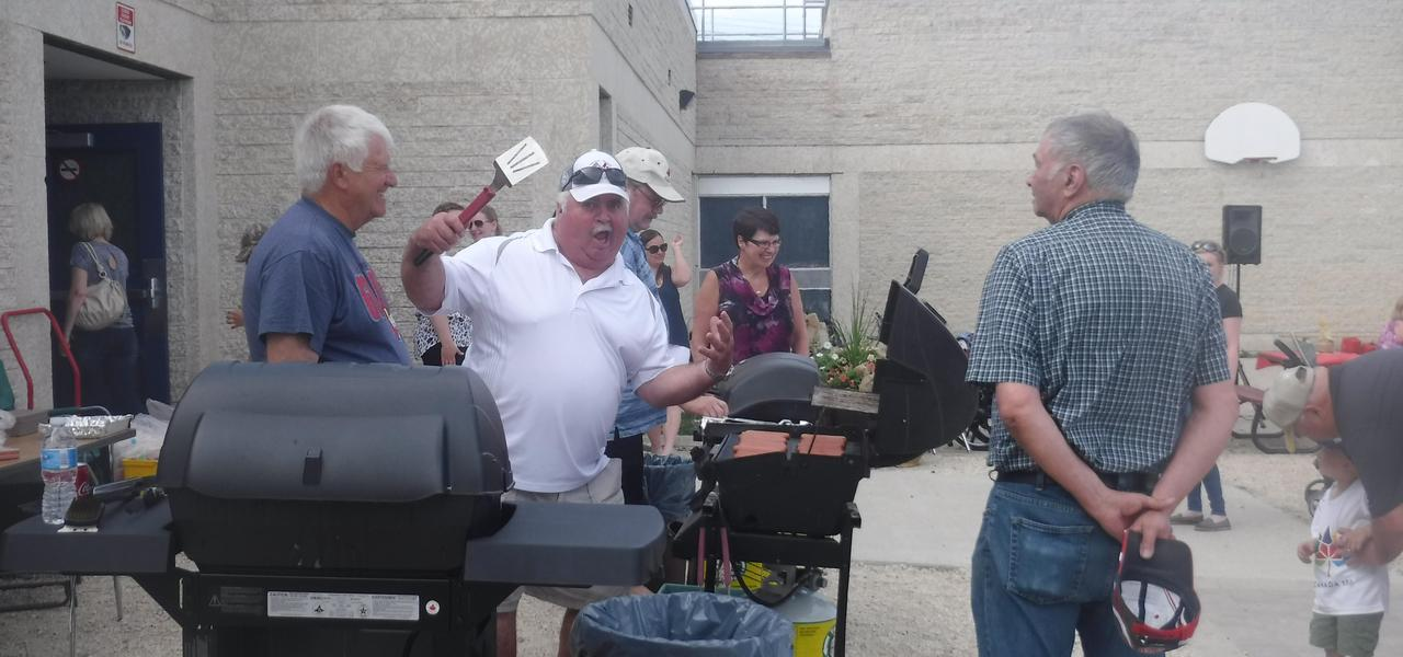 Community members helping out with the BBQ meal.